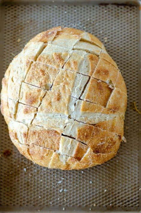 Bread on baking sheet cut downwards