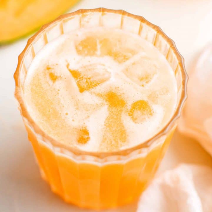 Close up of Agua de Melon over ice in glass