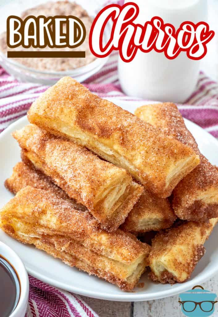 Easy Baked Churro recipe from The Country Cook, a stack of cinnamon sugar churros shown on a white round plate