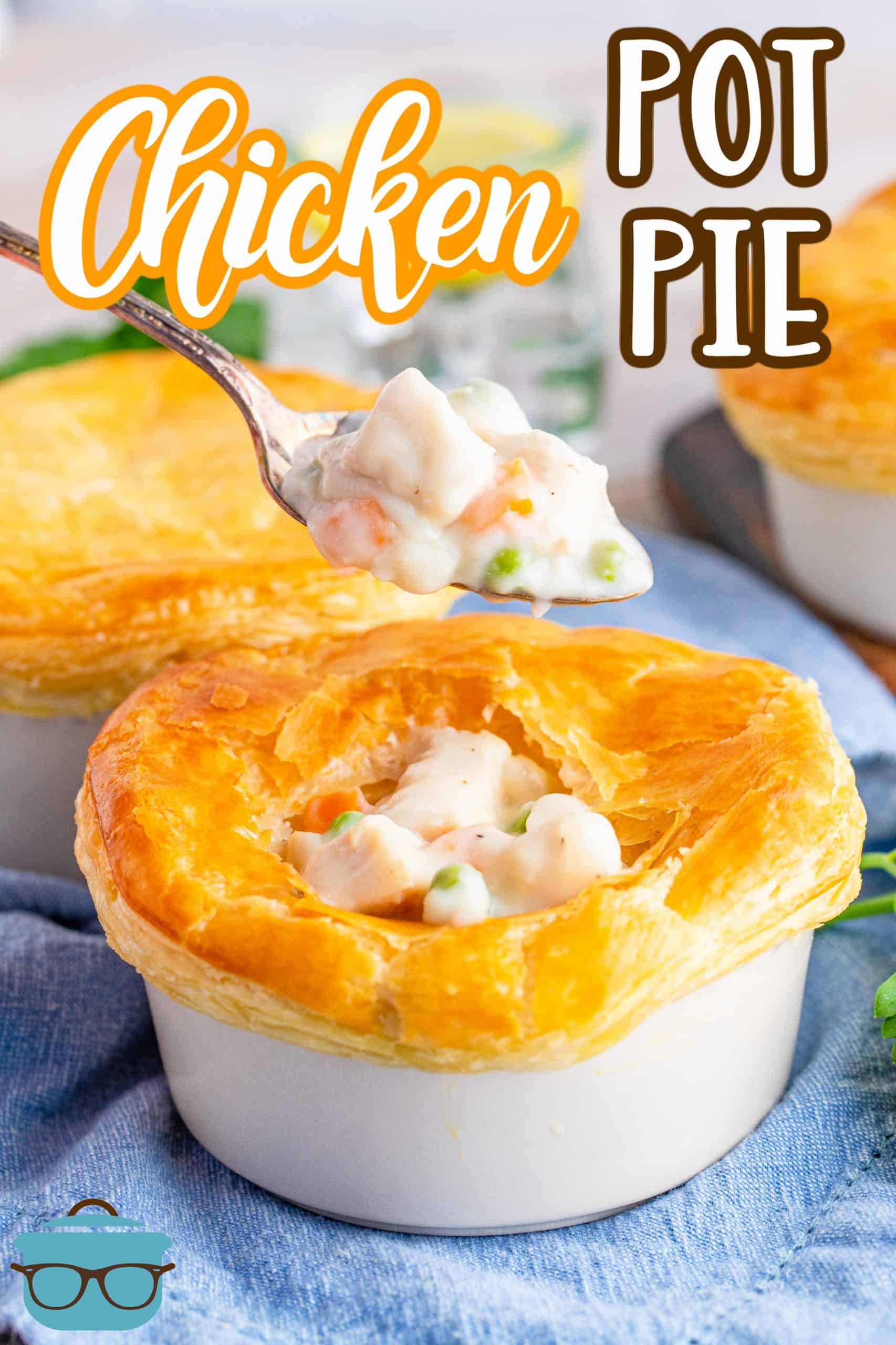 Easy Homemade Chicken Pot Pie recipe from The Country Cook, pot pie showin in a small white ramekin with a spoon above it holding some of the pot pie filling.