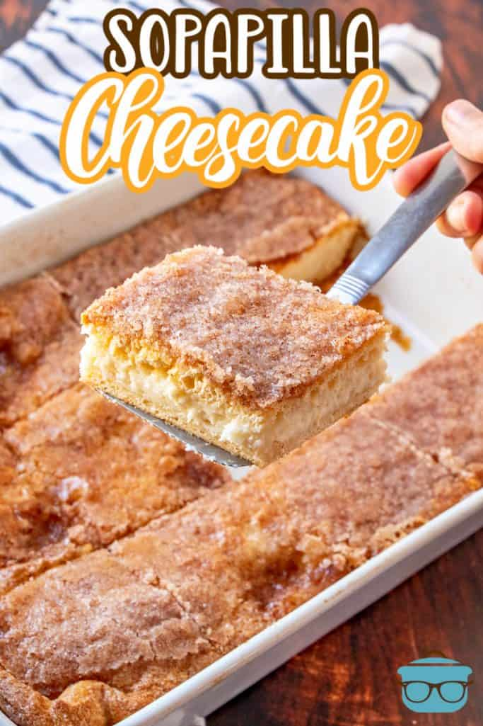 Sopapilla Cheesecake Bars recipe from The Country Cook, shown with a spatula removing one cheesecake bar from a baking pan
