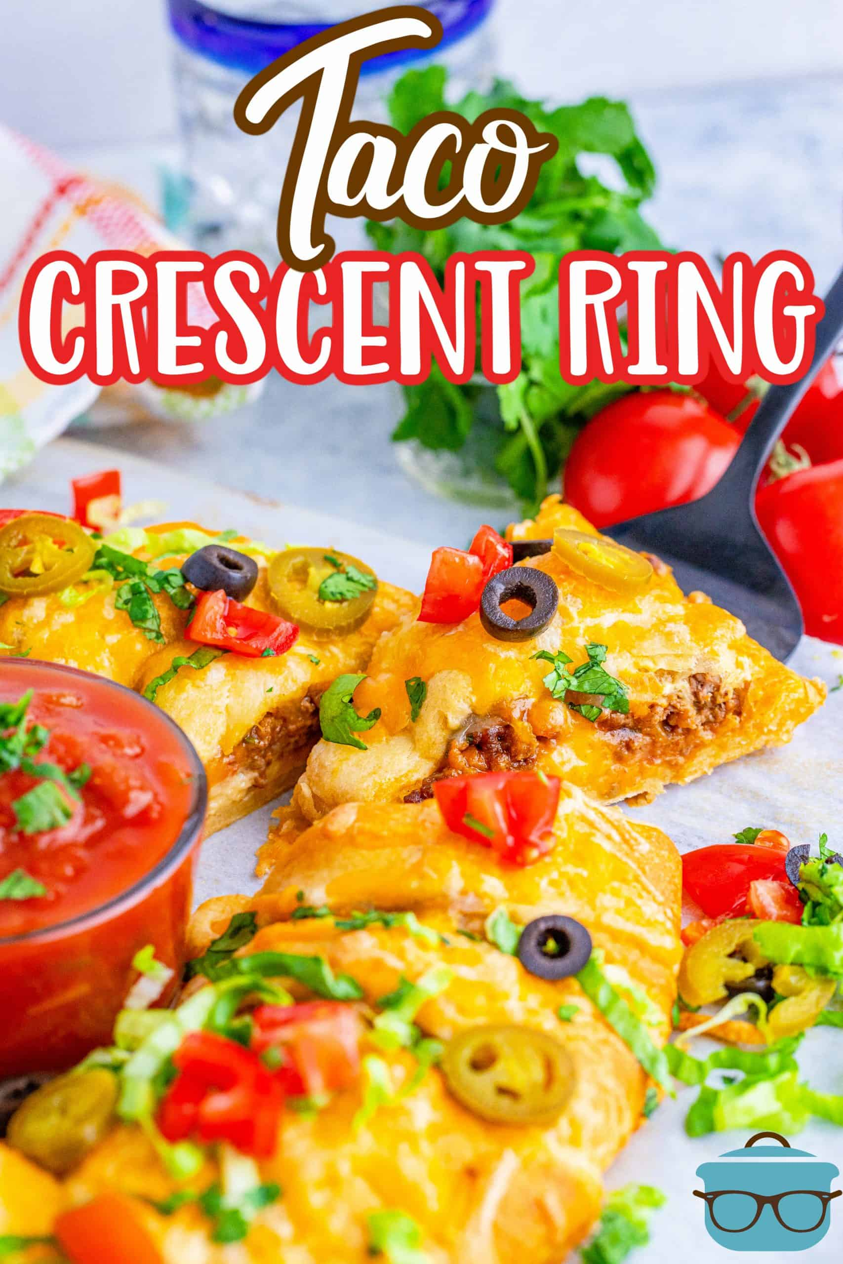 Finished Taco Crescent Ring Recipe with slice being pulled out Pinterest image