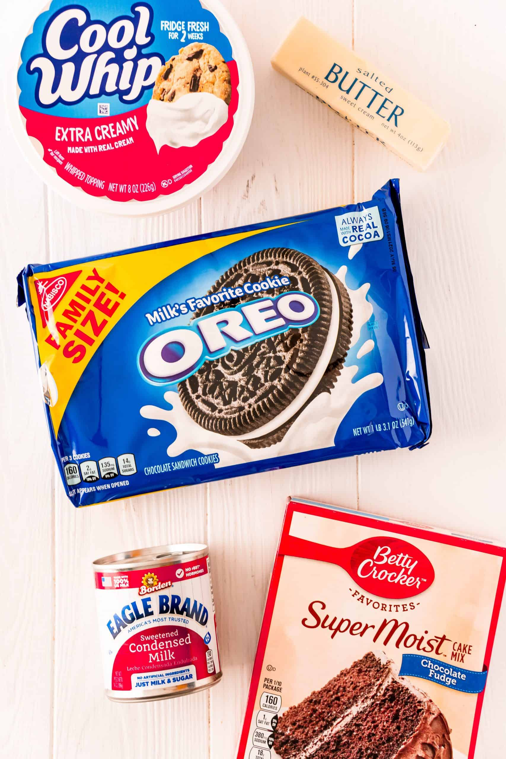Ingredients needed for Oreo Dump Cake: Oreo cookies, sweetened condensed milk, whipped topping, chocolate cake mix and butter.