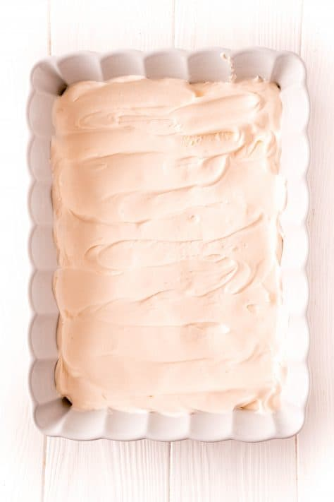 Whipped topping spray over sweetened condensed milk
