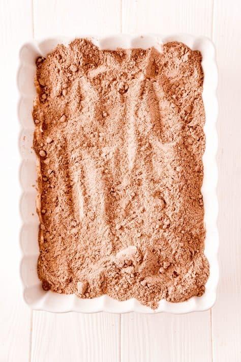 Cake mix sprinkled over sweetened condensed milk