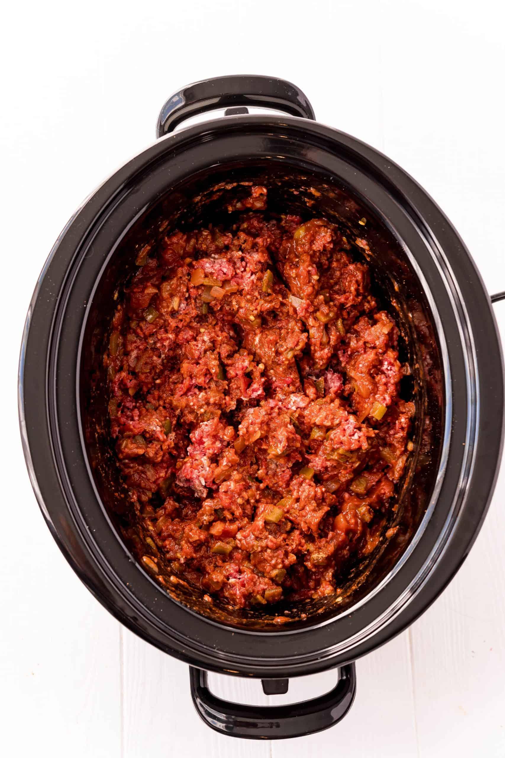 Ground beef added to black crock pot