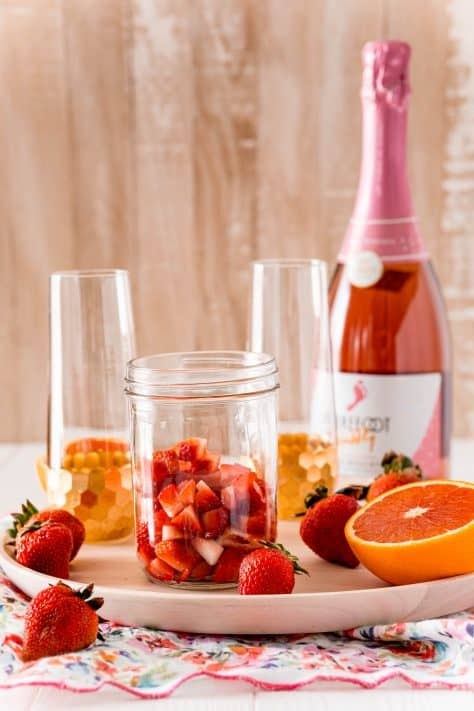 Ingredients needed for strawberry mimosas: strawberries, orange juice and moscato