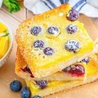 Square image of stacked Blueberry Lemon bars