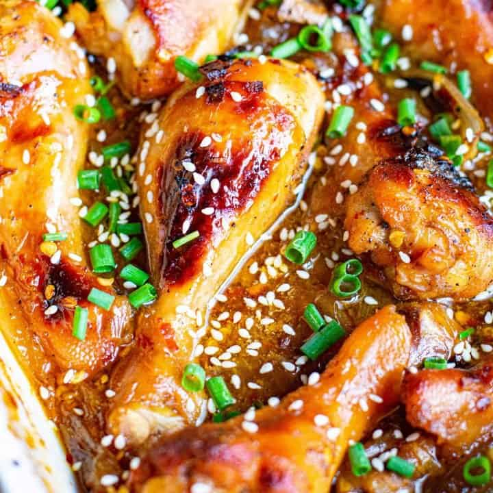 Square image of drumsticks in pan baked