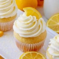 Square image of close up of one Homemade Lemon Cupcake with lemon wedge
