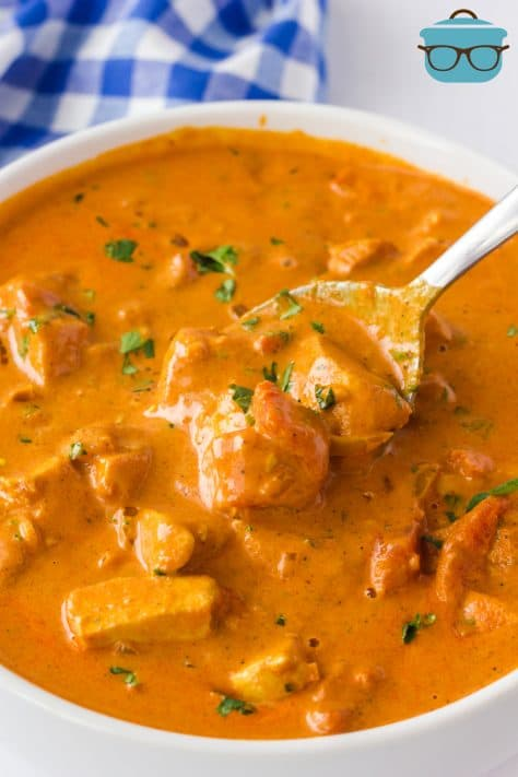 Bowl of Creamy Butter Chicken with spoon in bowl