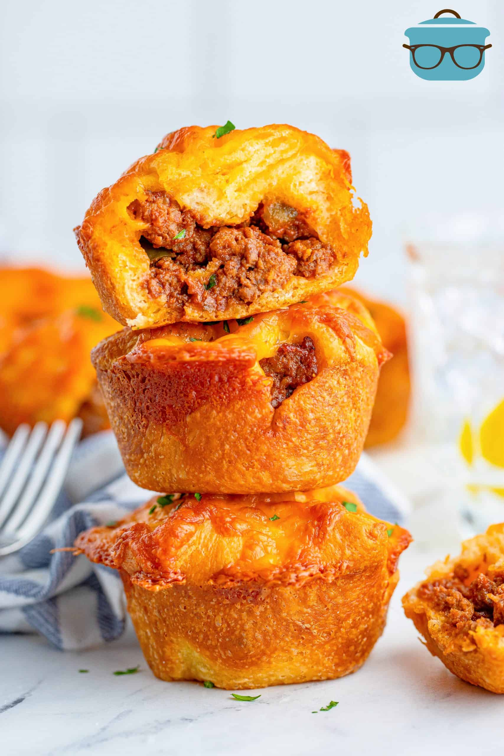 Three stacked Sloppy Joe Cups with top one cut open showing inside filling.
