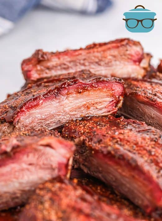 Stacked Smoked Beef Ribs on top of one another close up showing smoke ring