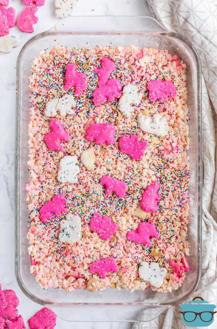 Finished Circus Animal Krispie Treats in pan topped with whole cookies