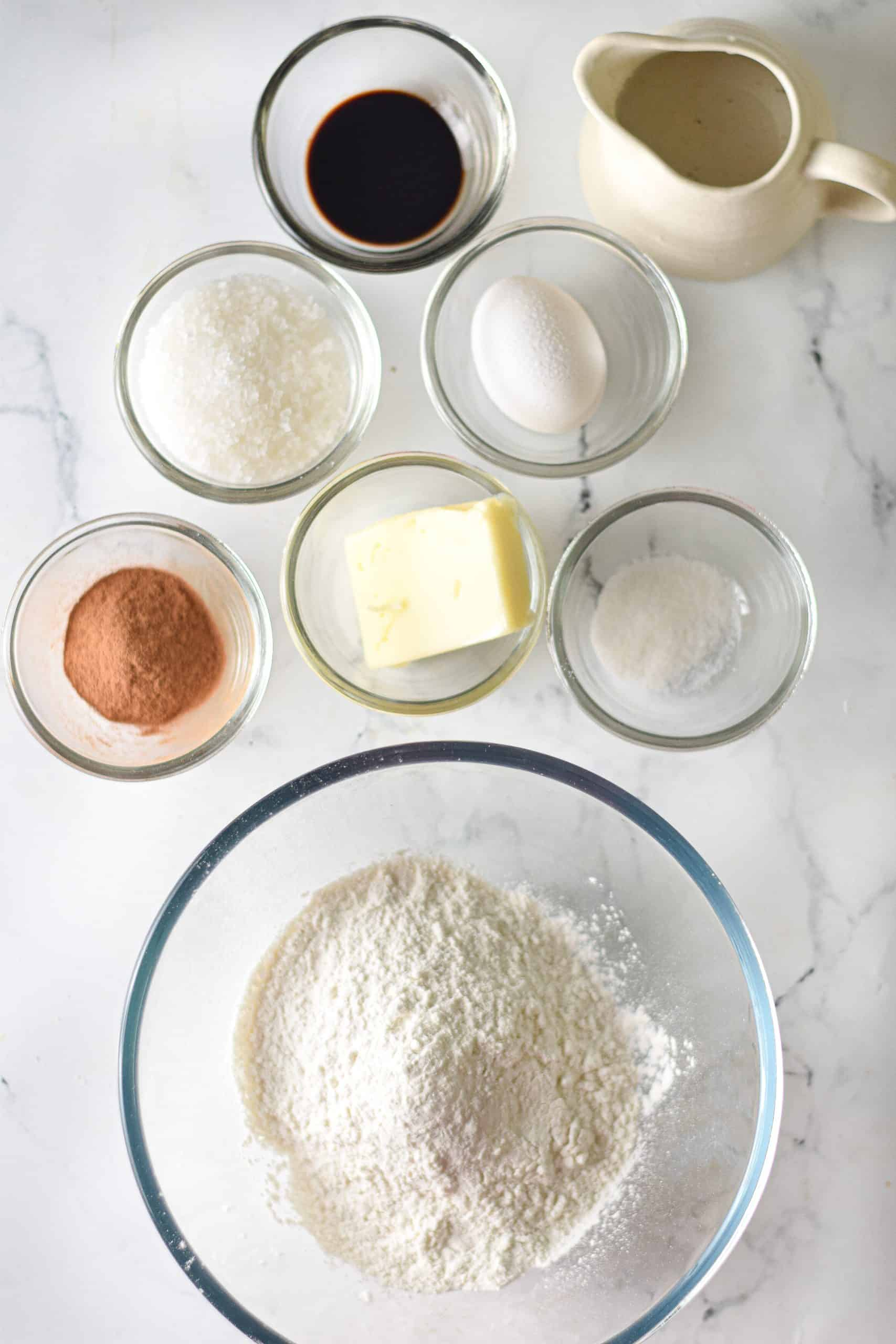 ingredients needed to make homemade churro bites: all purpose-flour, water, unsalted butter, sugar, vanilla extract, egg.