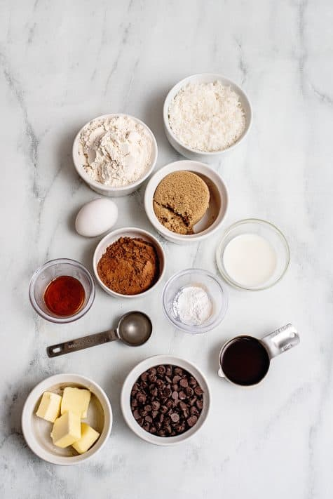 Ingredients needed: all purpose flour, unsweetened cocoa powder, baking powder, salt, light brown sugar, unsalted butter, egg , milk, hot coffee, vanilla extract, semisweet chocolate chips, light corn syrup and sweetened shredded coconut