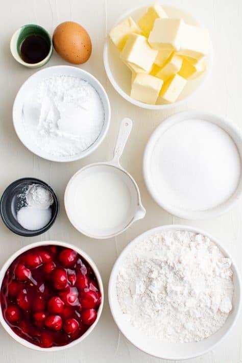Ingredients needed: all-purpose flour, granulated sugar, baking powder, salt, butter, egg , vanilla extract, cherry pie filling, powdered sugar and milk