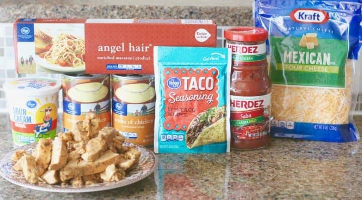 chicken spaghetti ingredients: angel hair pasta, cooked chicken, cream of chicken soup, salsa, sour cream, Mexican cheese blend, taco seasoning.