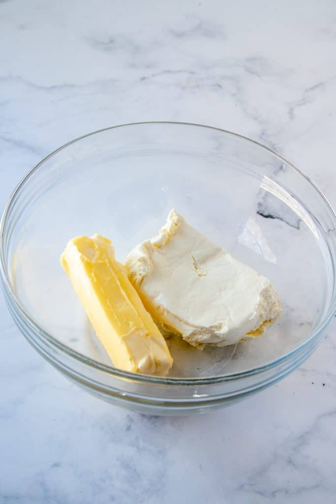 Butter and cream cheese in clear bowl