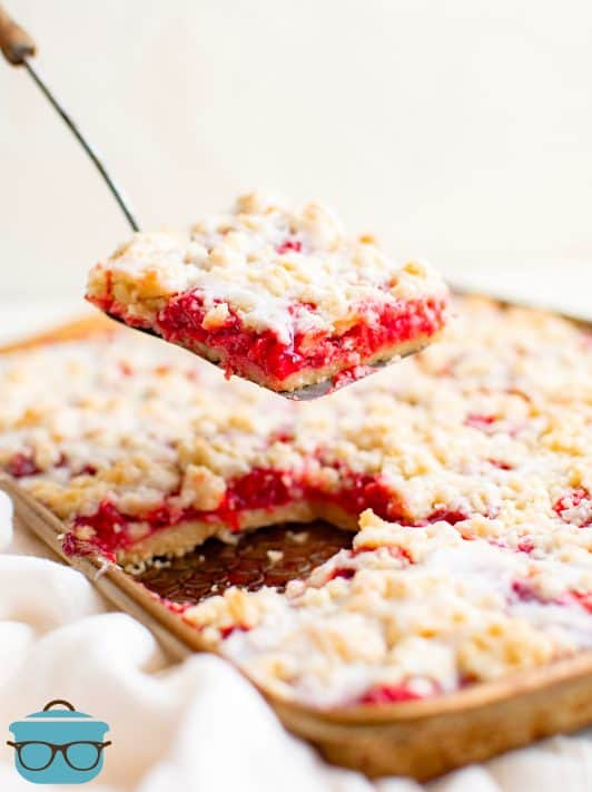 One Cherry Crumble Bar being lifted up by by bar server out of pan