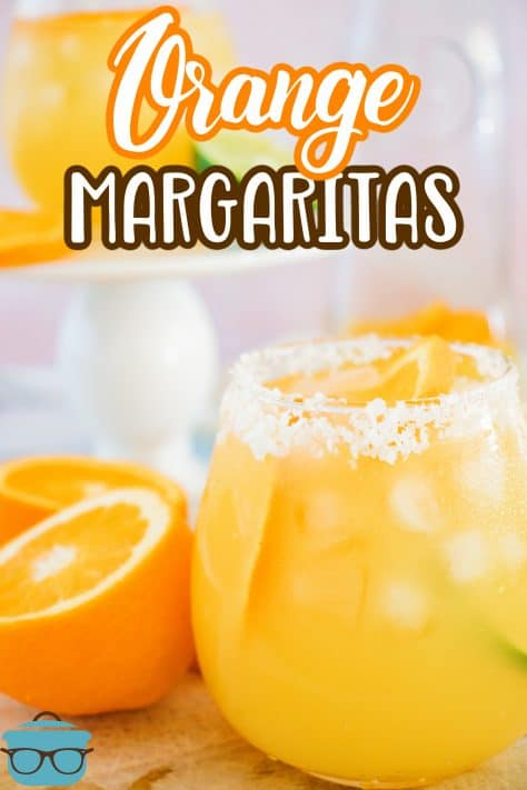 Garnished Orange Margaritas in glass with oranges around the outside Pinterest image