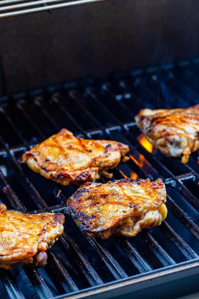 Chicken thighs getting brownon grill