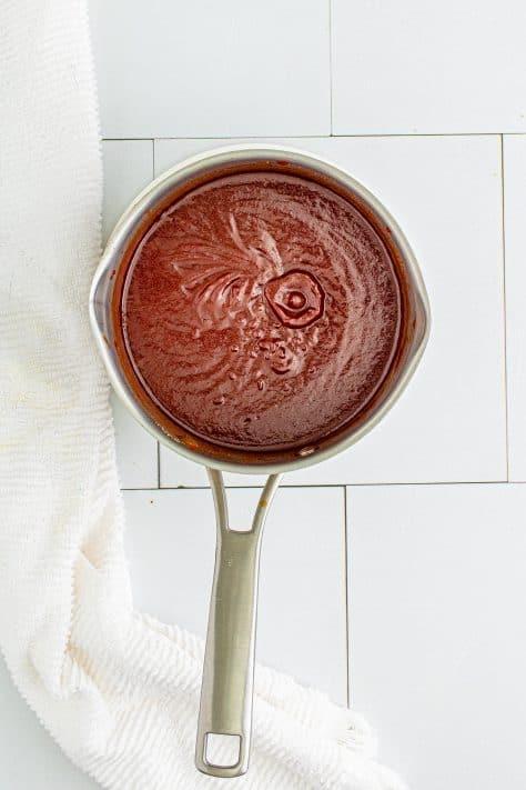 Homemade BBQ Sauce cooling in metal saucepan