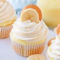 Square image of finished and garnished Banana Pudding Cupcake Recipe on white platter