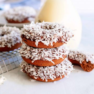 Square image of three stacked Chocolate Coconut Donuts
