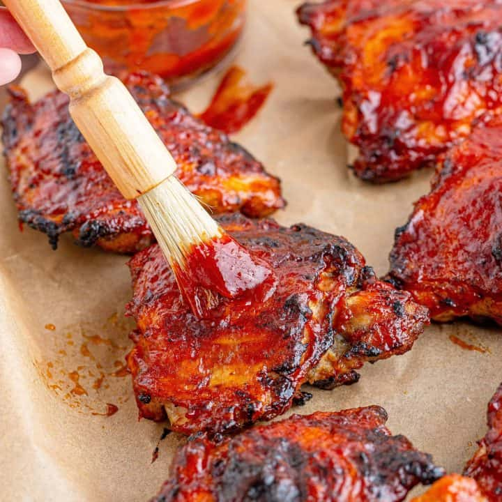 Close up of Homemade BBQ Sauce recipe basting chicken on pan
