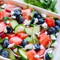 Square image of finished salad in white dish