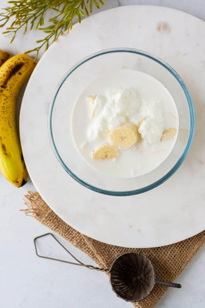 Yogurt and milk added to bowl.