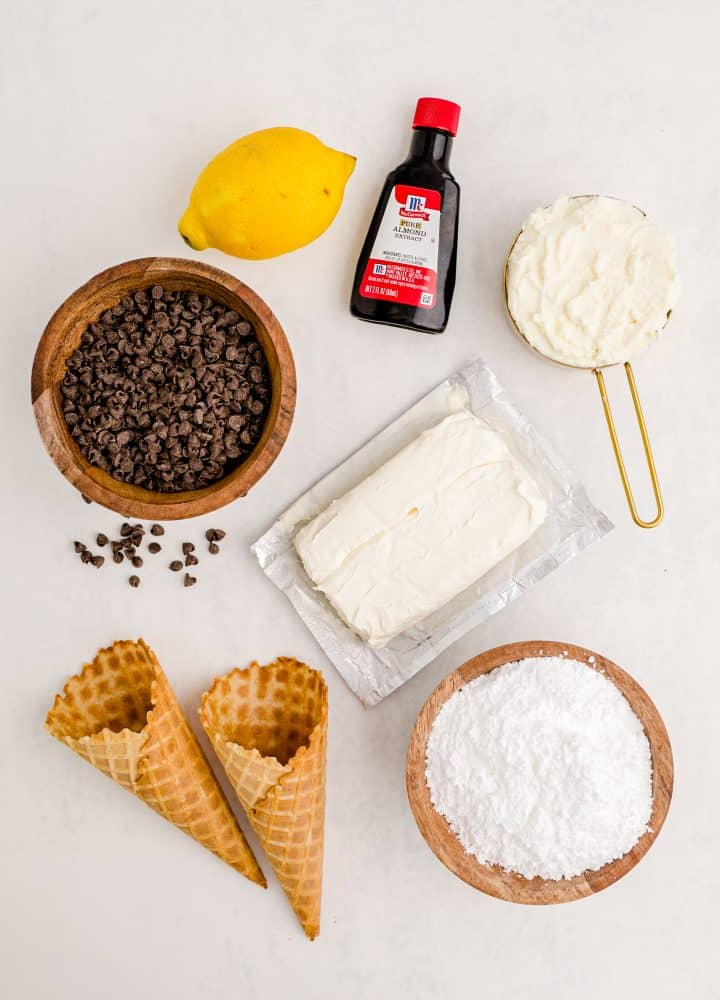 Ingredients needed: cream cheese, ricotta cheese, powdered sugar, almond extract, lemon zest, mini chocolate chips and waffle cones
