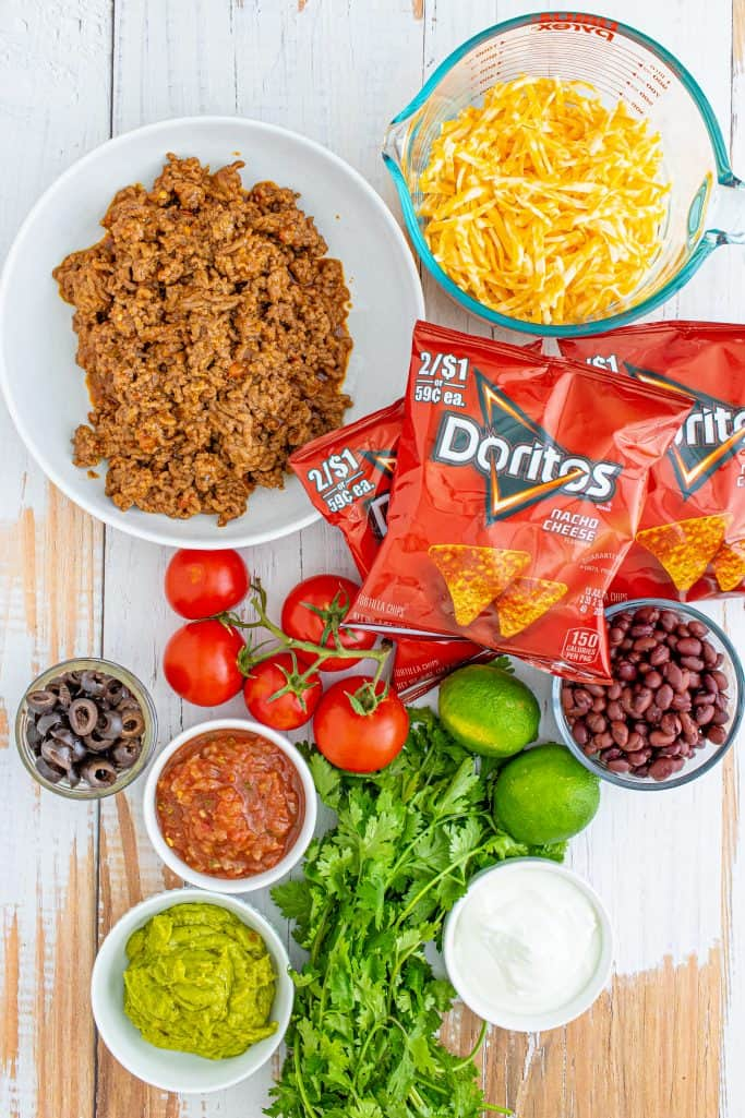 Ingredients needed: Doritos, seasoned taco meat, black beans, Colby Jack cheese and your Favorite Taco Toppings
