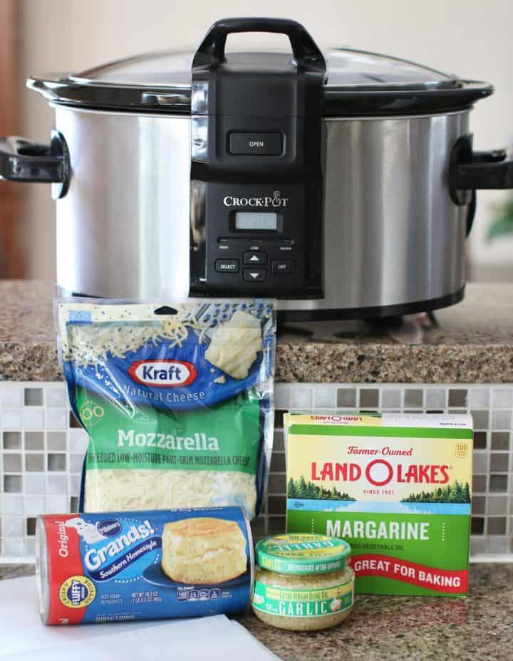 ingredients needed: refrigerated biscuits, margarine, minced garlic, shredded mozzarella cheese