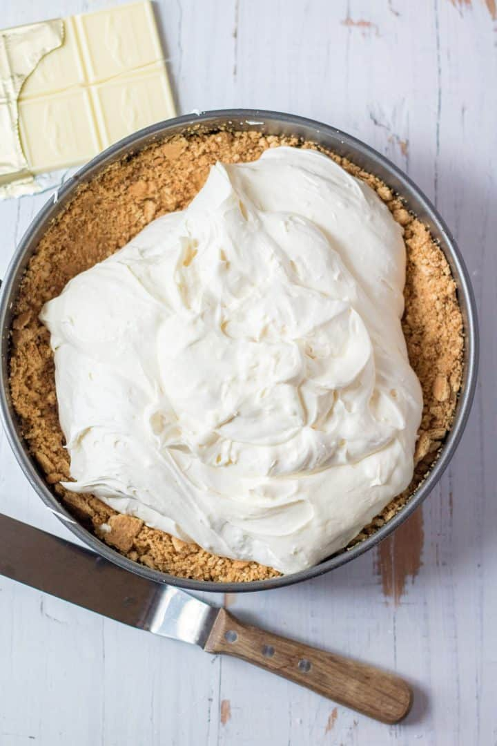 Cheesecake batter poured into crust