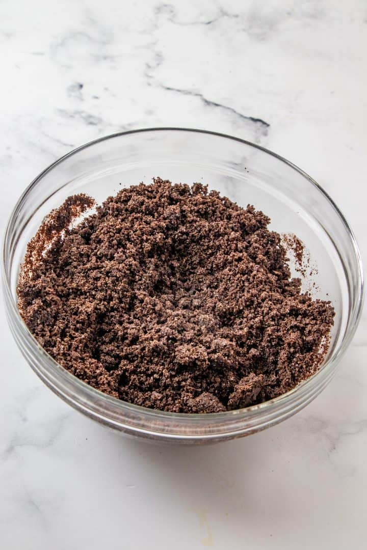 Crumb mixture stirred together in a glass bowl.
