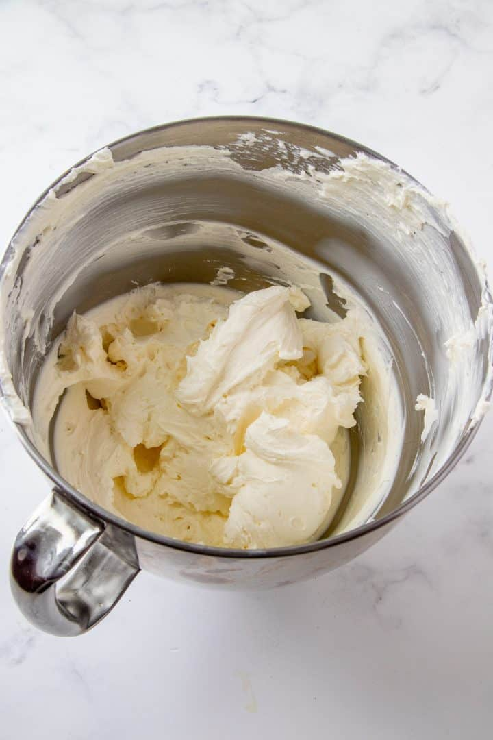 Beaten cream cheese in bowl of stand mixer.