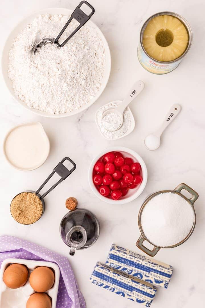 Ingredients needed: butter, brown sugar, pineapple rings, maraschino cherries, cake flour, baking powder, salt, granulated sugar, eggs, vanilla extract, evaporated milk and pineapple juice
