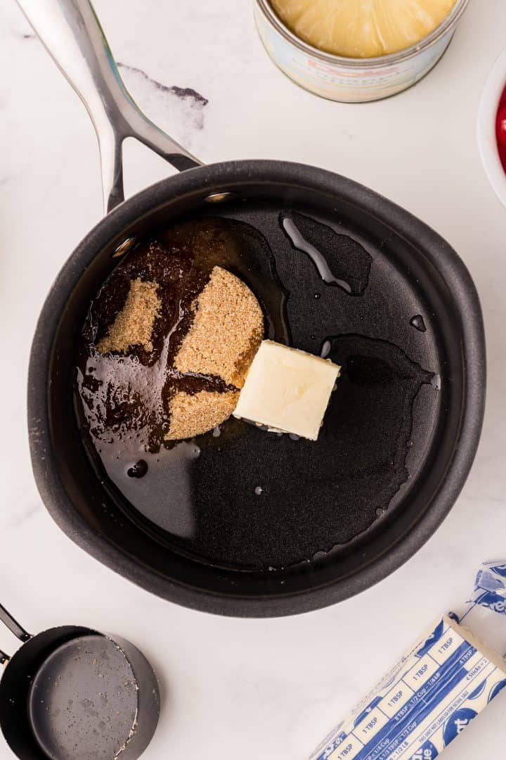 Butter and brown sugar in pan being melted