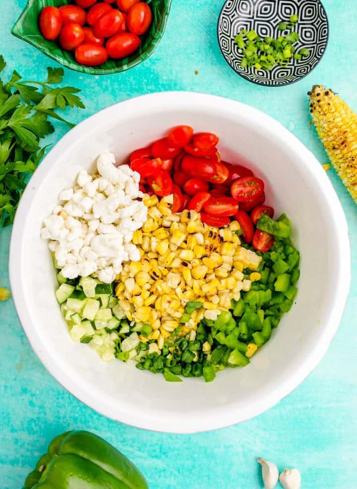 Salad ingredients in white bowl