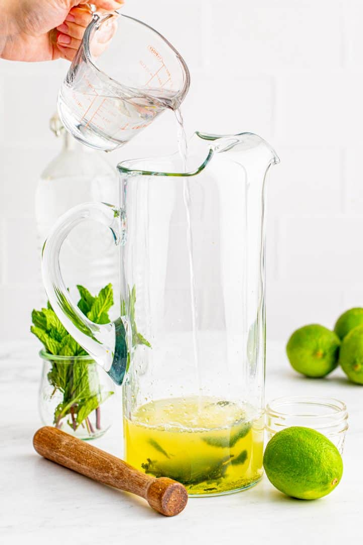 Rum being poured into pitcher.