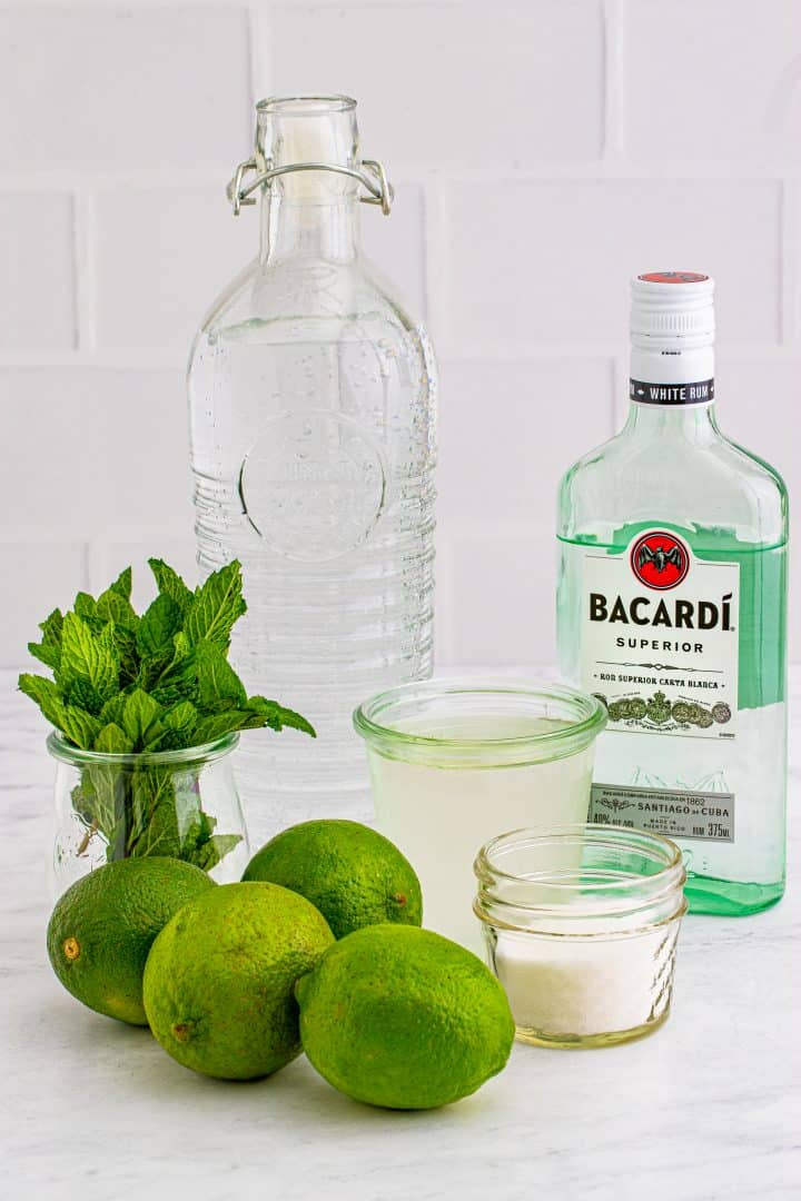 Ingredients needed: limes, mint, granulated sugar, simple syrup, white rum, club soda and ice.