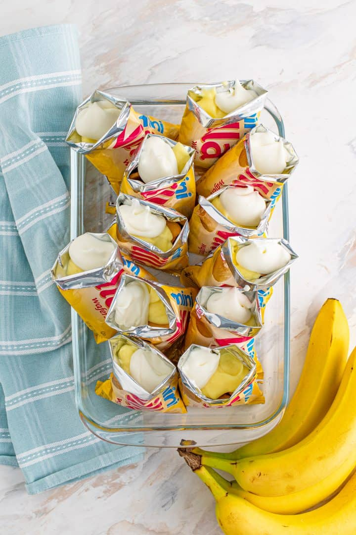Whipped topping added to top of pudding in Nilla wafer cookie bags