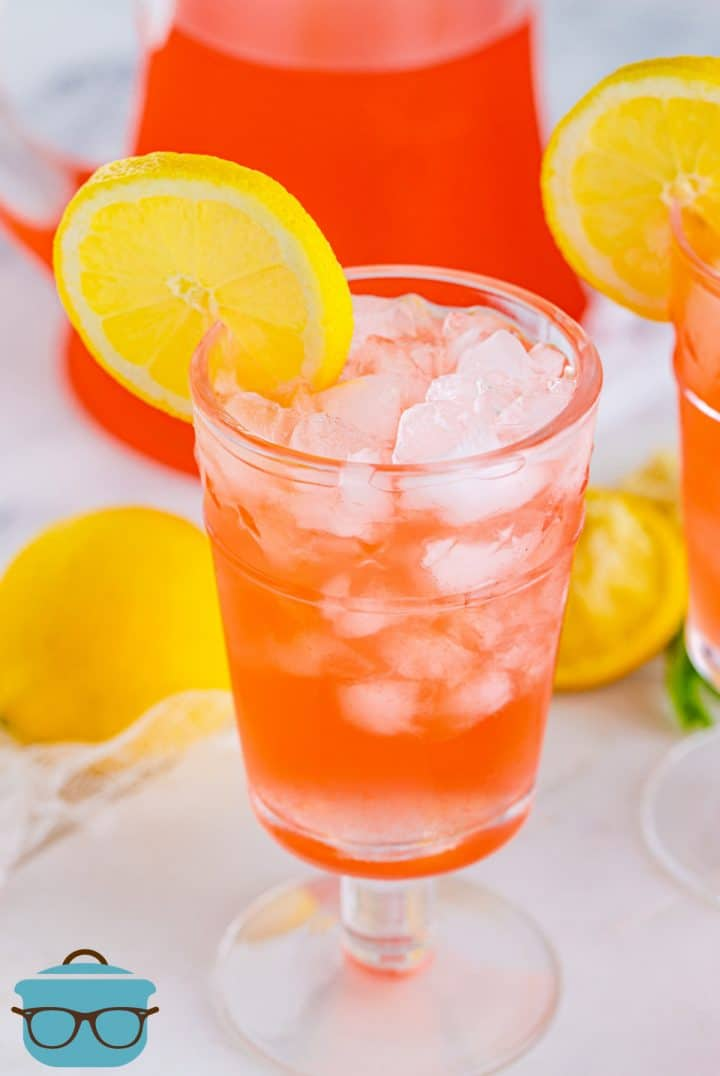 Pink Lemonade Recipe in glass with ice garnished with lemon