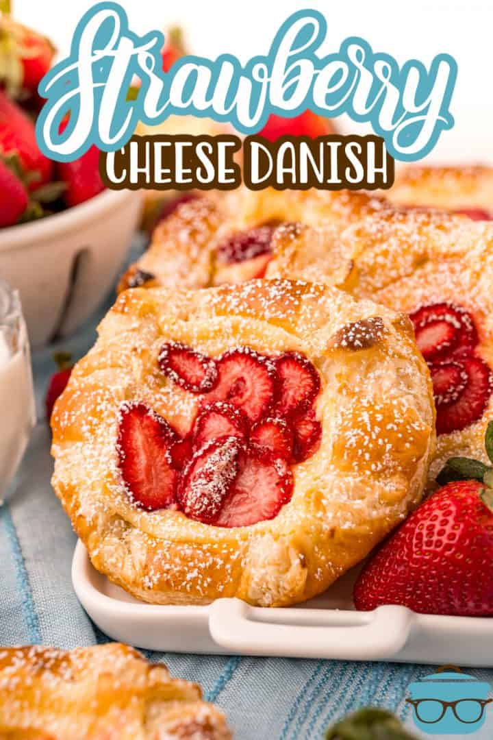 Close up of one Strawberry Cheese Danish topped with powdered sugar Pinterest image