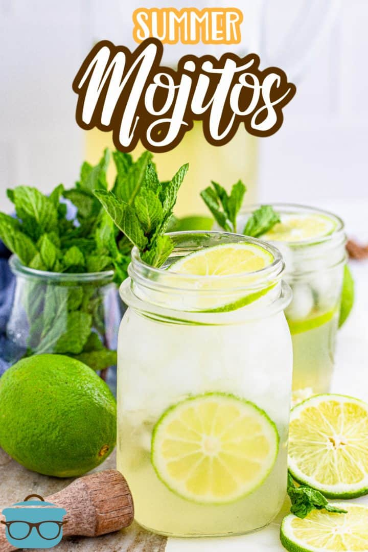 Close up of a glass of Summer Mojitos with limes and mint with fresh mint leaves in the background.