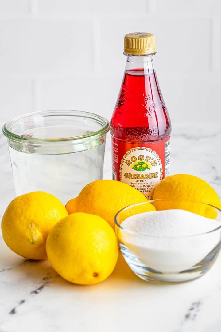 Ingredients needed to make Homemade Pink Lemonade: water, sugar, lemon juice and grenadine