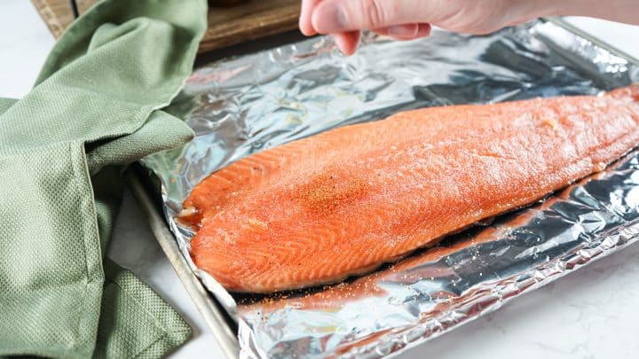 BBQ Rub being sprinkled over salmon filet