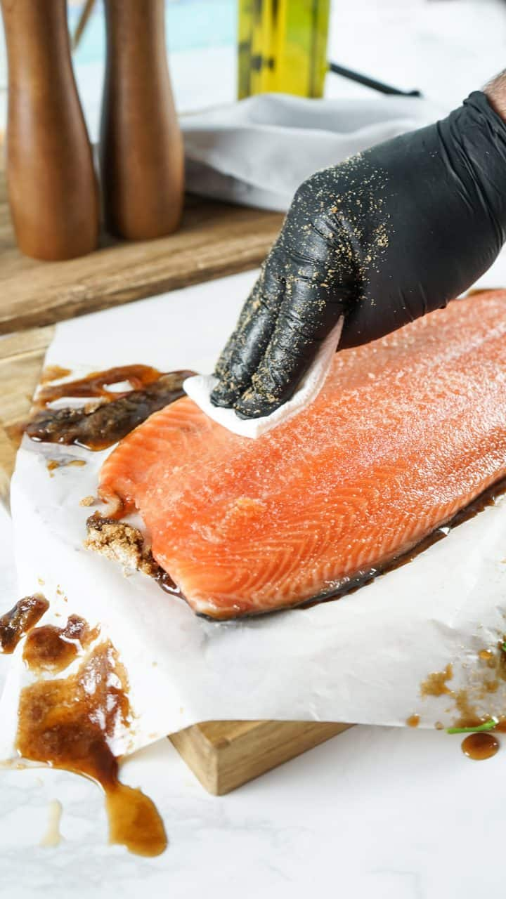 Salmon being wiped down after refrigeration